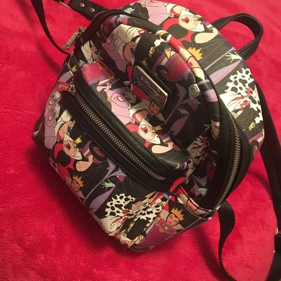 690082ba9e4 Loungefly Handbags - Lounge Fly Disney villains mini backpack purse